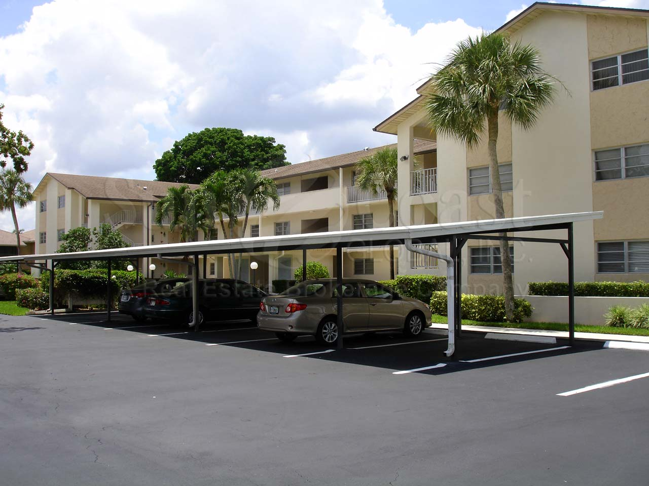 Country club gardens at palm river real estate naples for Country carports
